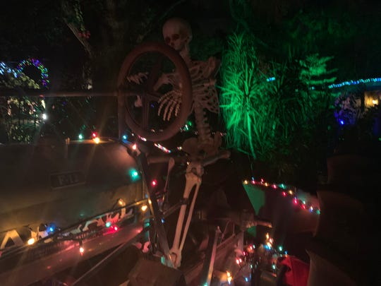 One home on Pinchot Avenue between 26th and 28th Streets shows a skeleton driving a tractor in December 2018.