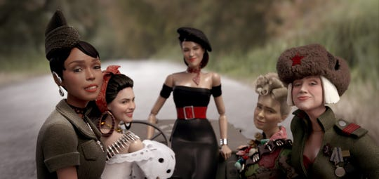 """The dolls of the fictional town of Marwen (from left): GI Julie (Janelle Monáe), Carlala (Eiza Gonzalez), Suzette (Leslie Zemeckis), Roberta (Merritt Wever) and Anna (Gwendoline Christie) in """"Welcome to Marwen,"""" directed by Robert Zemeckis."""