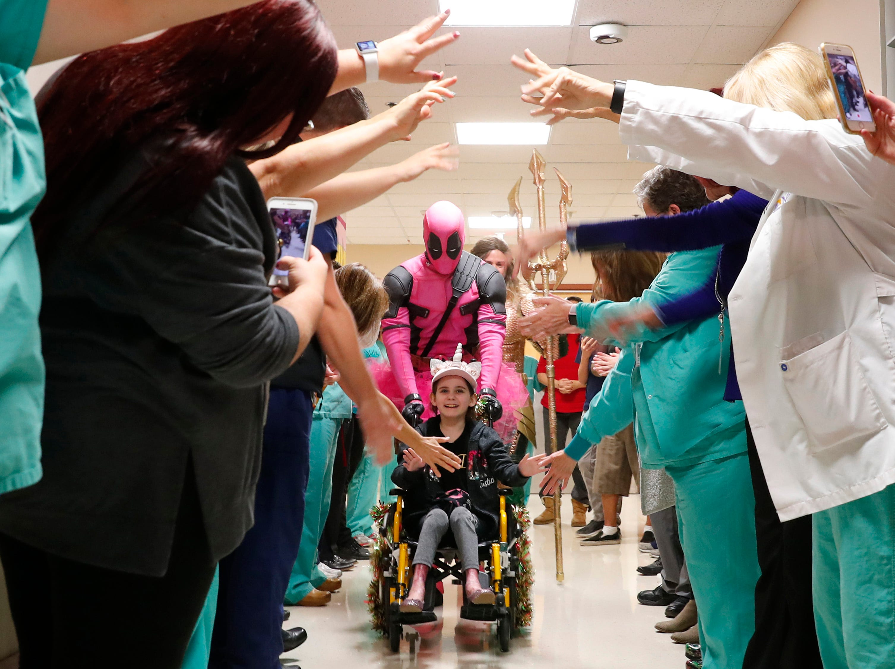Nurses and staff say goodbye to Isabella McCune at the Arizona Burn Center in Phoenix December 17, 2018. The nine-year-old was being discharged nine months to the day after she was severely burned in a home accident in March.