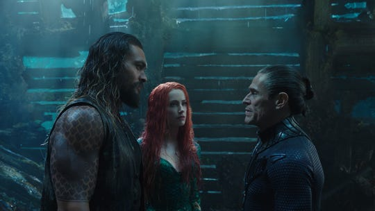 "Jason Momoa (left), Amber Heard and Willem Dafoe star in ""Aquaman."""