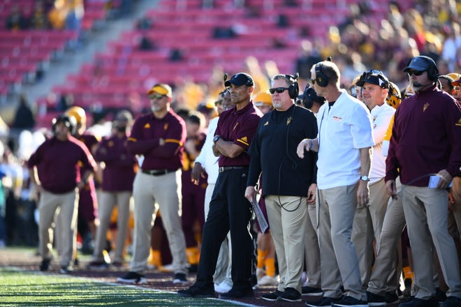 Herm Edwards, center with arms crossed, has been a hit beyond a 7-6 record in his first season as Arizona State football coach.