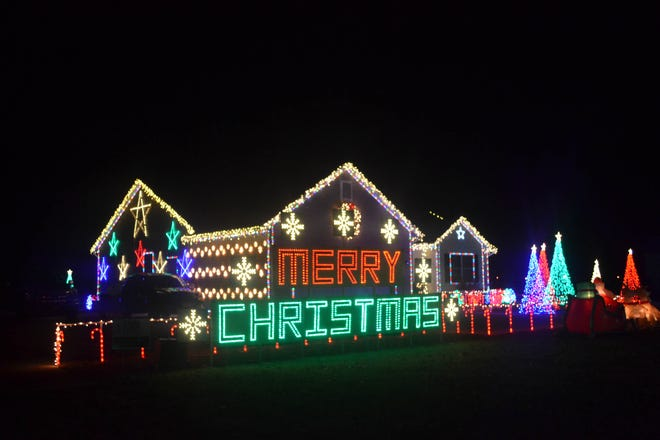 "The ""Merry Christmas"" sign is the newest addition to Chris and Sherry Lewandowski's holiday display at their home at 410 E. 4th St. in Genoa."