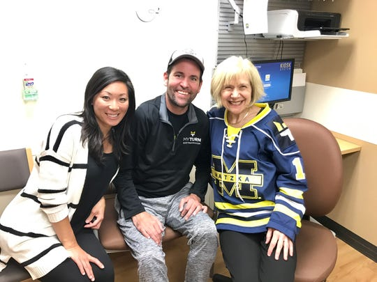 Catie Matzka, Scott Matzka and Russell N. DeJong Professor of Neurology at the University of Michigan Dr. Eva Feldman pose for a photo.