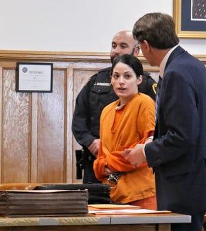 Nicole Addimando speaks to one of her defense attorneys,  John Ingrassia, in Dutchess County Court on Dec. 17, 2018.