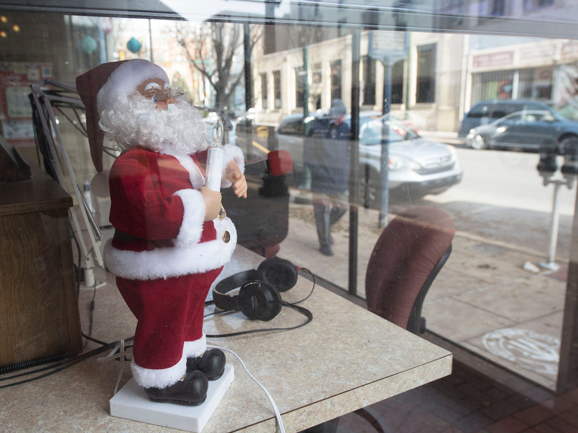 Santa rests on a desk at New Talk 103.7 in downtown Chambersburg.