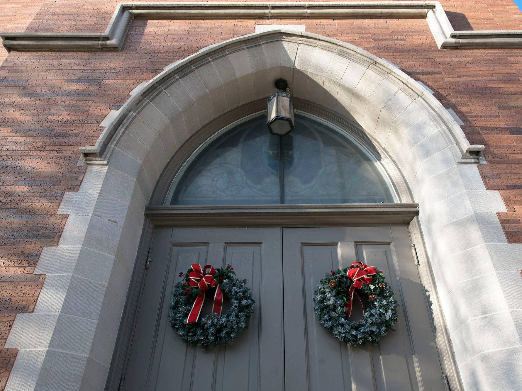 Church doors are decorated with wreaths along East King Street in Shippensburg.