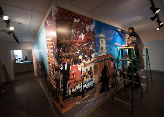 Murals depicting each Franklin County borough are placed on walls at Franklin County Visitors Center on Memorial Square, Chambersburg, on Monday, December 17, 2018. The FC Visitors Bureau continues to decorate their new building at 15 South Main Street.
