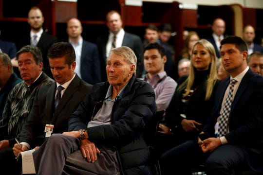 Former Baltimore Orioles third baseman Brooks Robinson, center, attends an introductory news conference for new Orioles manager Brandon Hyde, Monday, Dec. 17, 2018, in Baltimore. Hyde is the 20th manager in the team's history. (AP Photo/Patrick Semansky)