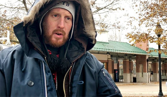 Casey Bowling, 37, talks about York Giving Helping Hands as volunteers serve food to those in need near the Rabbittransit transfer station in York City, Sunday, Dec. 9, 2018. Dawn J. Sagert photo