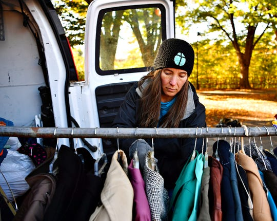 Volunteer Kim Sanger hangs coats on a rack while York Giving Helping Hands also serves hot food to those in need in York City, Saturday, Nov. 10, 2018. Dawn J. Sagert photo