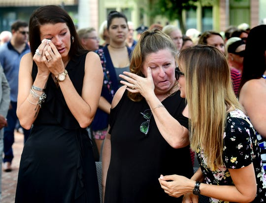From left, Brooke Anthony, Barb Michaels and Casey Flanscha react during a recognition for actions during the fire and collapse at the former Weaver Organ and Piano building during the York City Fire Department's awards ceremony at York City Hall Thursday, August 16, 2018. Ivan Flanscha (Casey's husband) and Zach Anthony (Brooke's husband) lost their lives fighting the March blaze. Michaels is the wife of York City Fire Chief Dave Michaels. Tony Caruso was named Firefighter of the Year during the ceremony. Bill Kalina photo