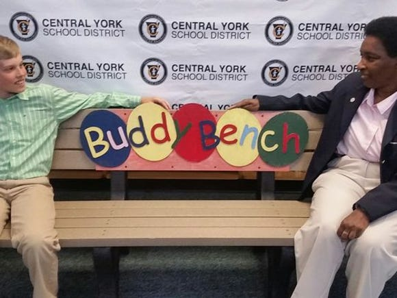Christian Bucks, left, and Loretta Claiborne share a Buddy Bench.