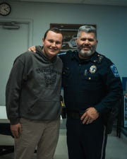 Ryan Dellinger, a 17-year-old Hellam Township resident who is battling leukemia, stands with Police Chief Doug Pollock. Hellam Township Police raised $1,200 during No-Shave November and decided to donate the money to Ryan, for him to use in any way that will make his cancer fight easier.