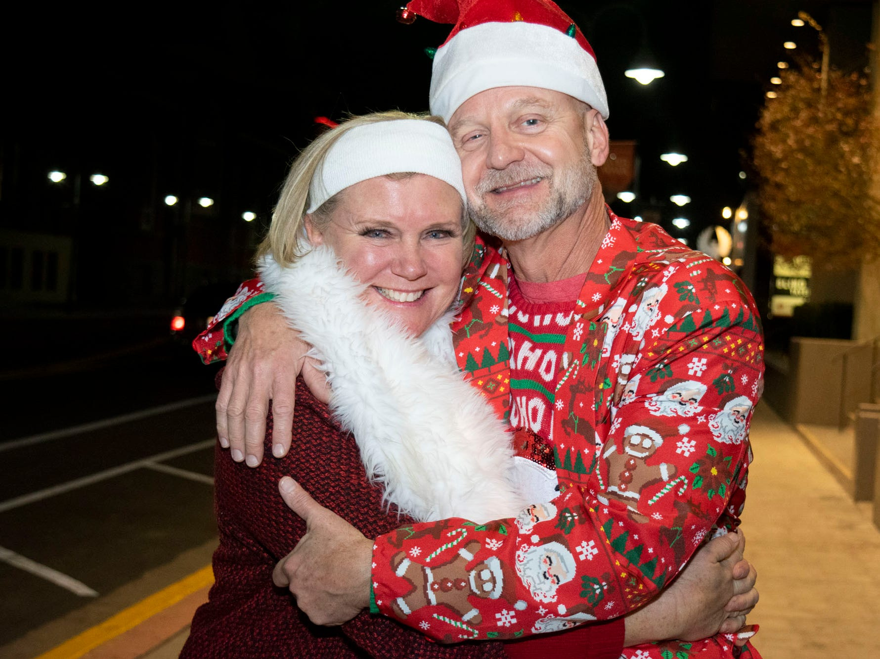 Karen and David Tillitt get merry at the Reno Santa Pub Crawl on Saturday, Dec. 15, 2018.