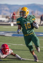 Bishop Manogue Miners  Peyton Dixon (10) runs against the Arbor View Aggies  on Nov. 24,2018.