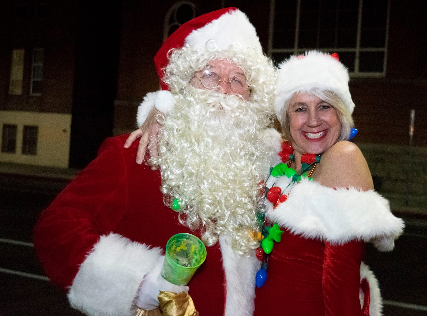 Doug and Cindy Lewis get merry at the Reno Santa Pub Crawl on Saturday, Dec. 15, 2018.