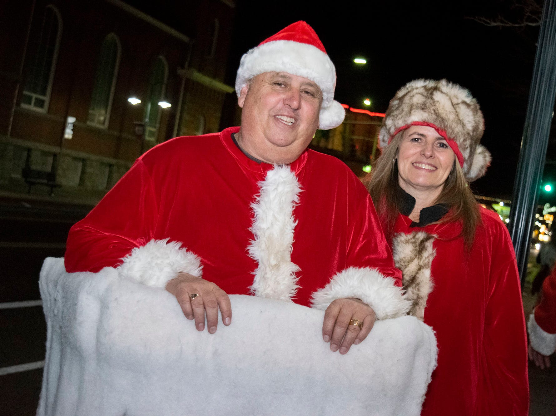 Barry O'Sullivan and Rachel Martinez get merry at the Reno Santa Pub Crawl on Saturday, Dec. 15, 2018.