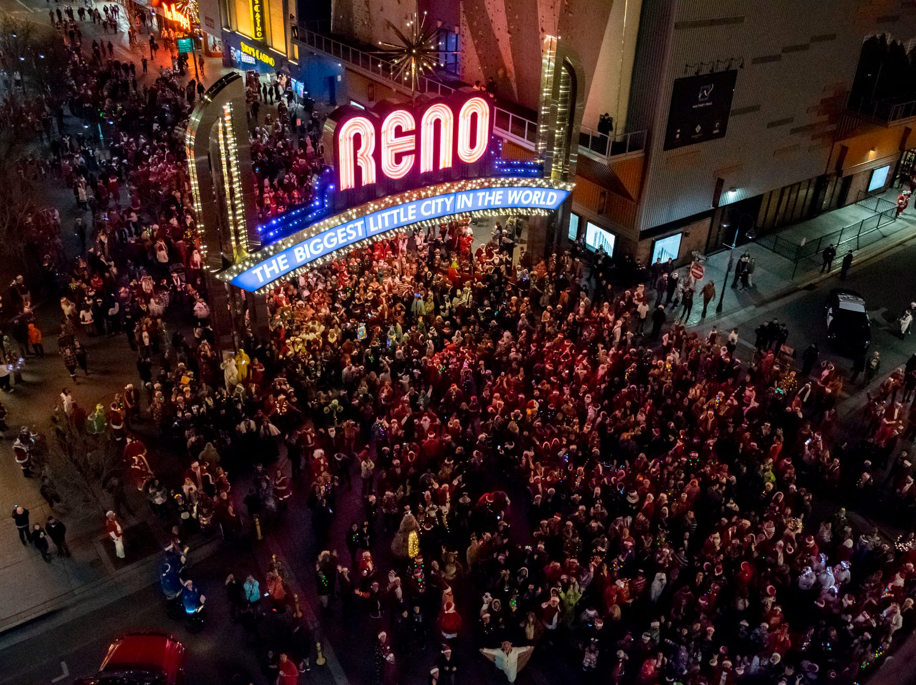 Elves, Christmas trees, and yes, Santas, get merry at the Reno Santa Pub Crawl on Saturday, Dec. 15, 2018.