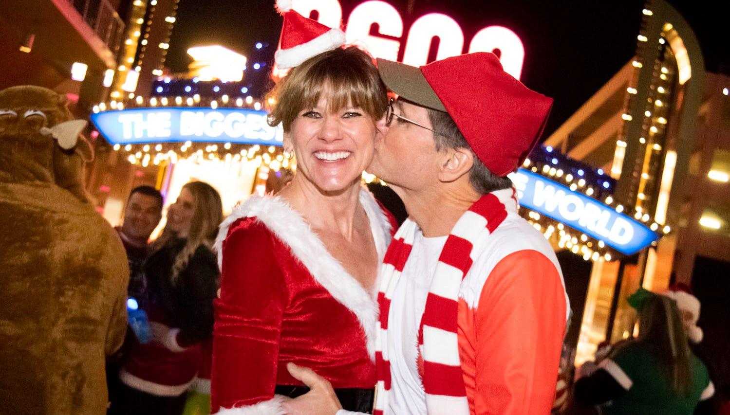Elves, Christmas trees, Grinches, and yes, Santas, all get merry at the Reno Santa Pub Crawl on Saturday, Dec. 15, 2018.