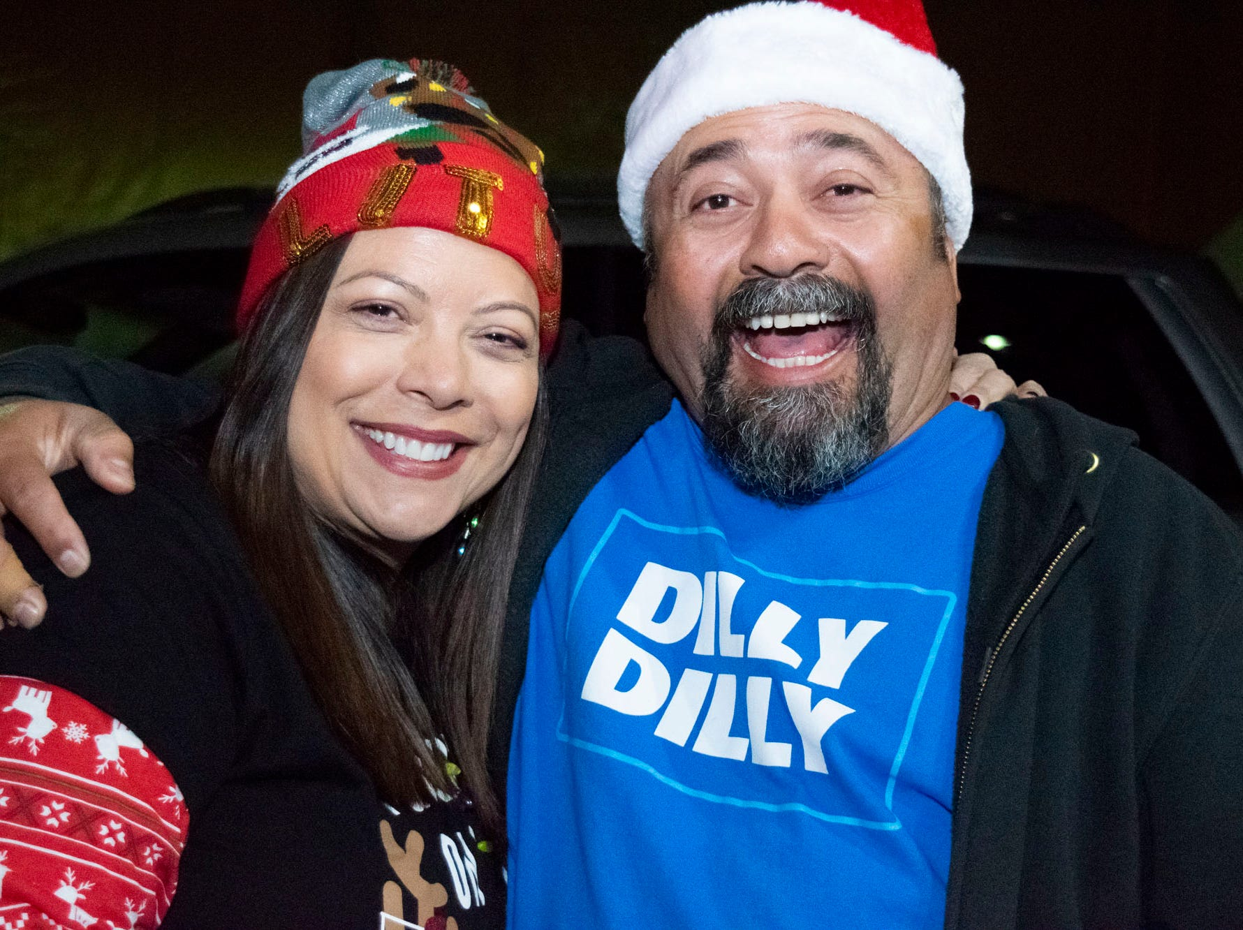 Gina and Tony Cuevas get merry at the Reno Santa Pub Crawl on Saturday, Dec. 15, 2018.