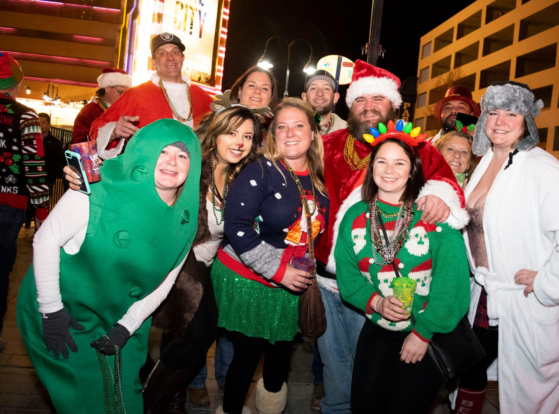 Elves, Christmas trees, Grinches, and yes, Santas, all get merry at the Reno Santa Pub Crawl on Saturday, Dec. 15, 2018.