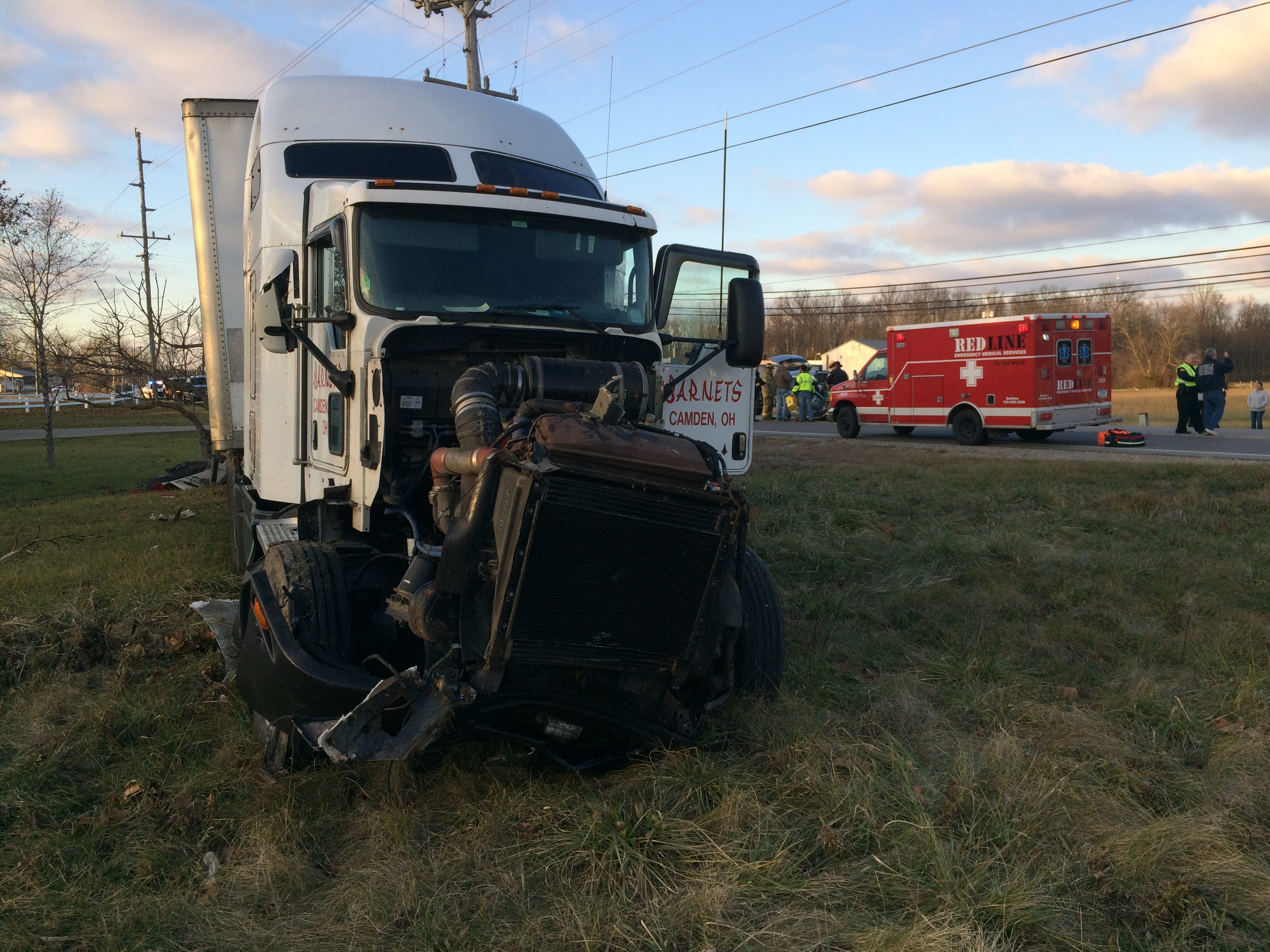 A damaged semi tractor-trailer stopped in grass adjacent to U.S. 35 after a three-vehicle accident Monday afternoon.