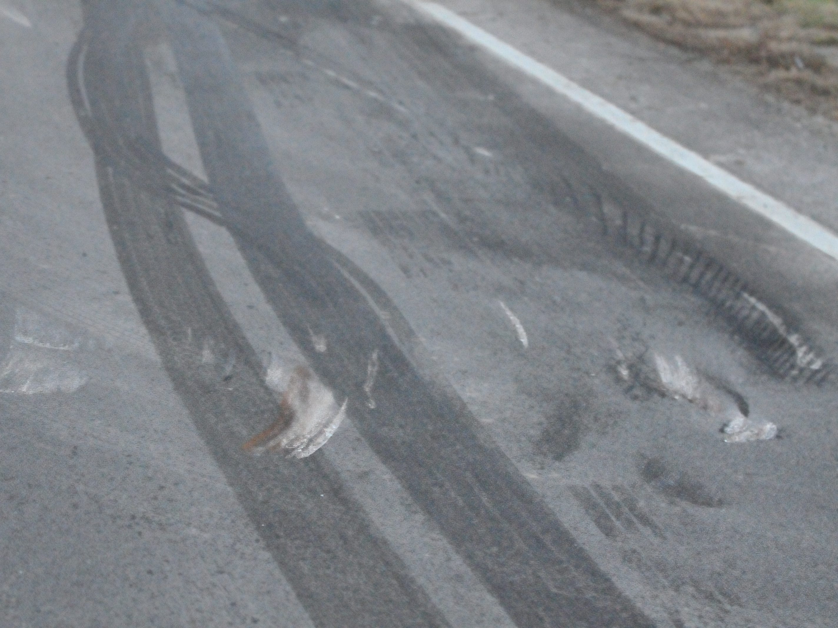 Gouges in the pavement indicate the point where a semi tractor-trailer struck a PT Cruiser on U.S. 35.