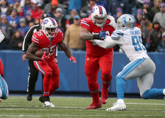 Bills running back Keith Ford, shown following the block of Dion Dawkins on Sunday, was activated from the practice squad last week and carried the ball 14 times for 46 yards in a win over the Lions.