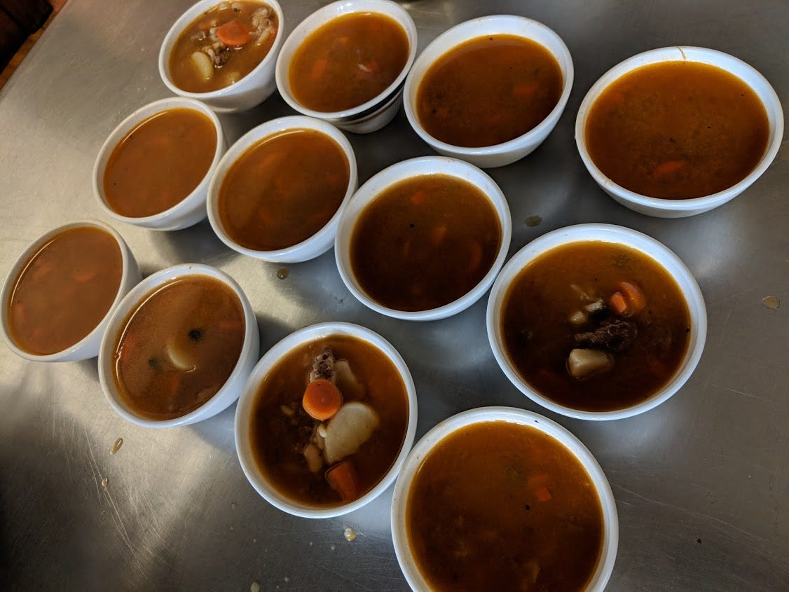 Rather than waste something, soup kitchen staff turned leftovers into vegetable-beef soup.