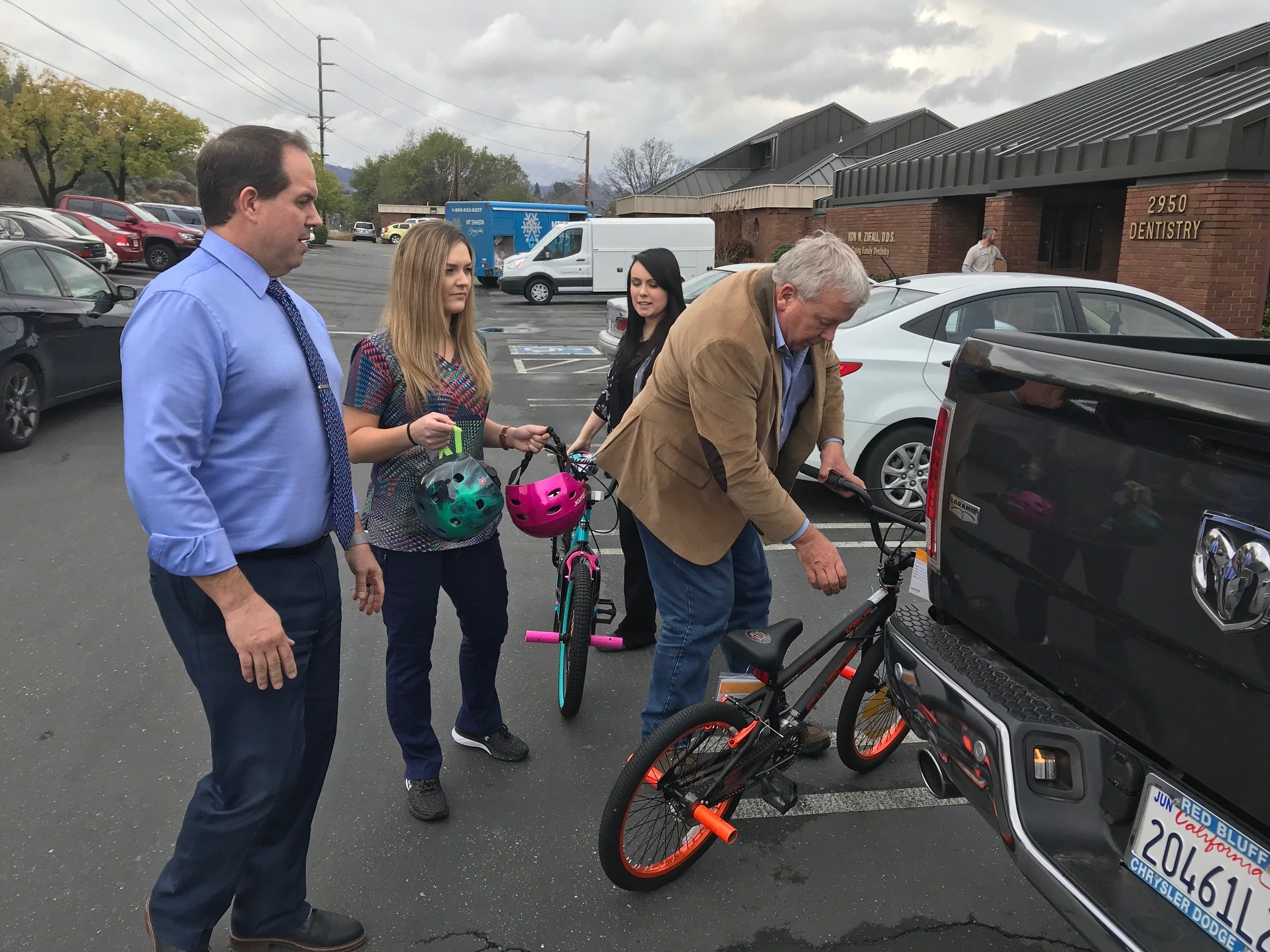 Ted Blankenheim picks up bicycles donated on Monday, Dec. 18, 2018 by Redding dentist Ron Zufall. Blankenheim will give the bikes away next week to foster children.