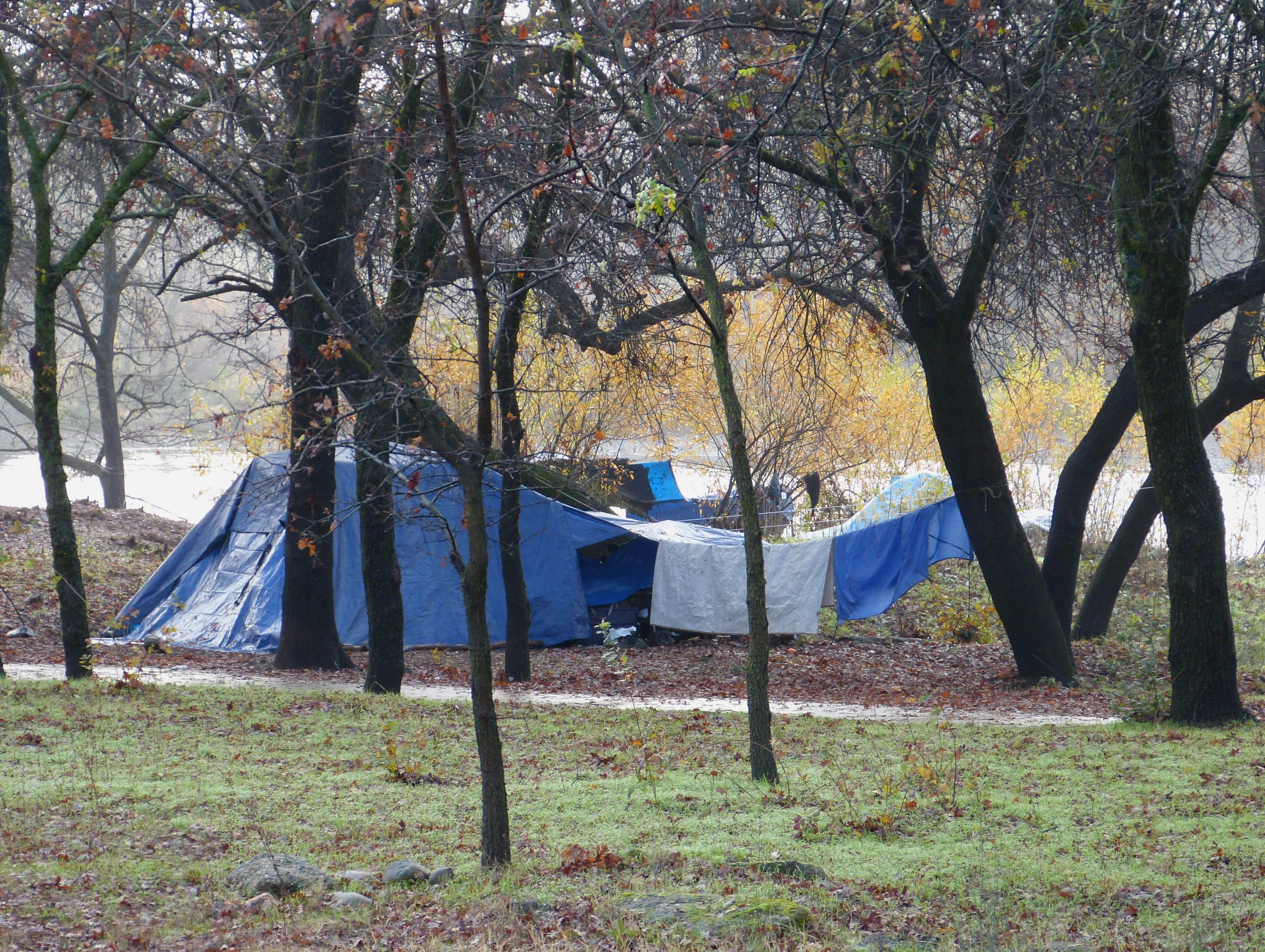"""A small """"tent city"""" at the Parkview Riverfront Park in Redding was established shortly after the Carr and Camp fires."""