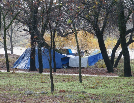 "A small ""tent city"" at the Parkview Riverfront Park in Redding was established shortly after the Carr and Camp fires."