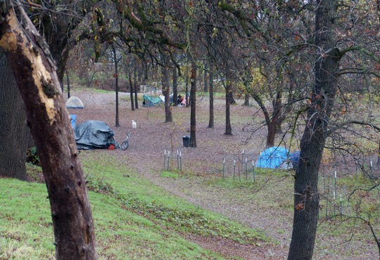 "A small ""tent city"" has cropped up at the Parkview Riverfront Park in Redding."