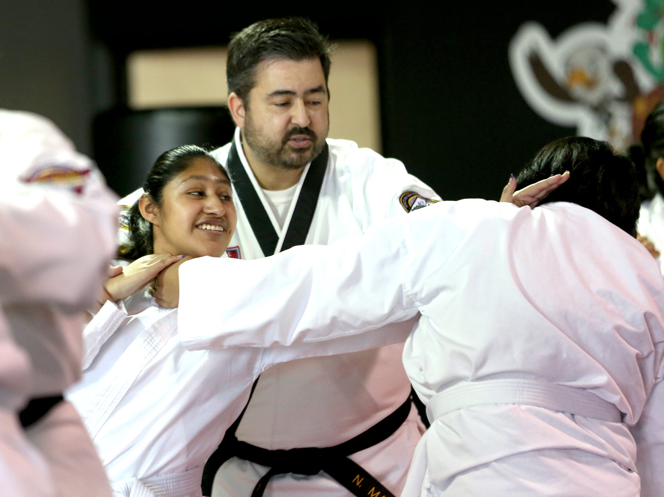 Martial arts instructor Nathaniel Mauro shows Janette Duran Peña a self-defense move as part of a Woodburn School District transition program at ATA Martial Arts Keizer on Thursday, Dec.13, 2018.