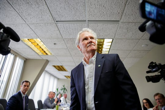 Former Gov. John Kitzhaber enters the room before the Oregon Government Ethics Commission voted on whether or not he violated state ethics laws 11 times while in office. Photographed at the Oregon Government Ethics Commission in Salem on Friday, Feb. 16, 2018.