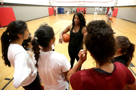 Former McKay and Oregon State basketball player Anna Marchbanks, center, leads the North Salem High School girl's basketball practice as head coach on Wednesday, June 22, 2016.