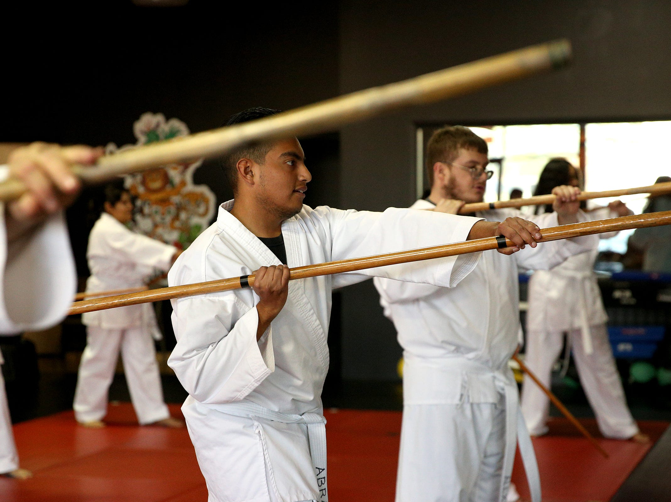 Abram Cortes practices uses a bo staff, during a self-defense martial arts class, as part of a Woodburn School District transition program at ATA Martial Arts Keizer on Thursday, Dec.13, 2018.