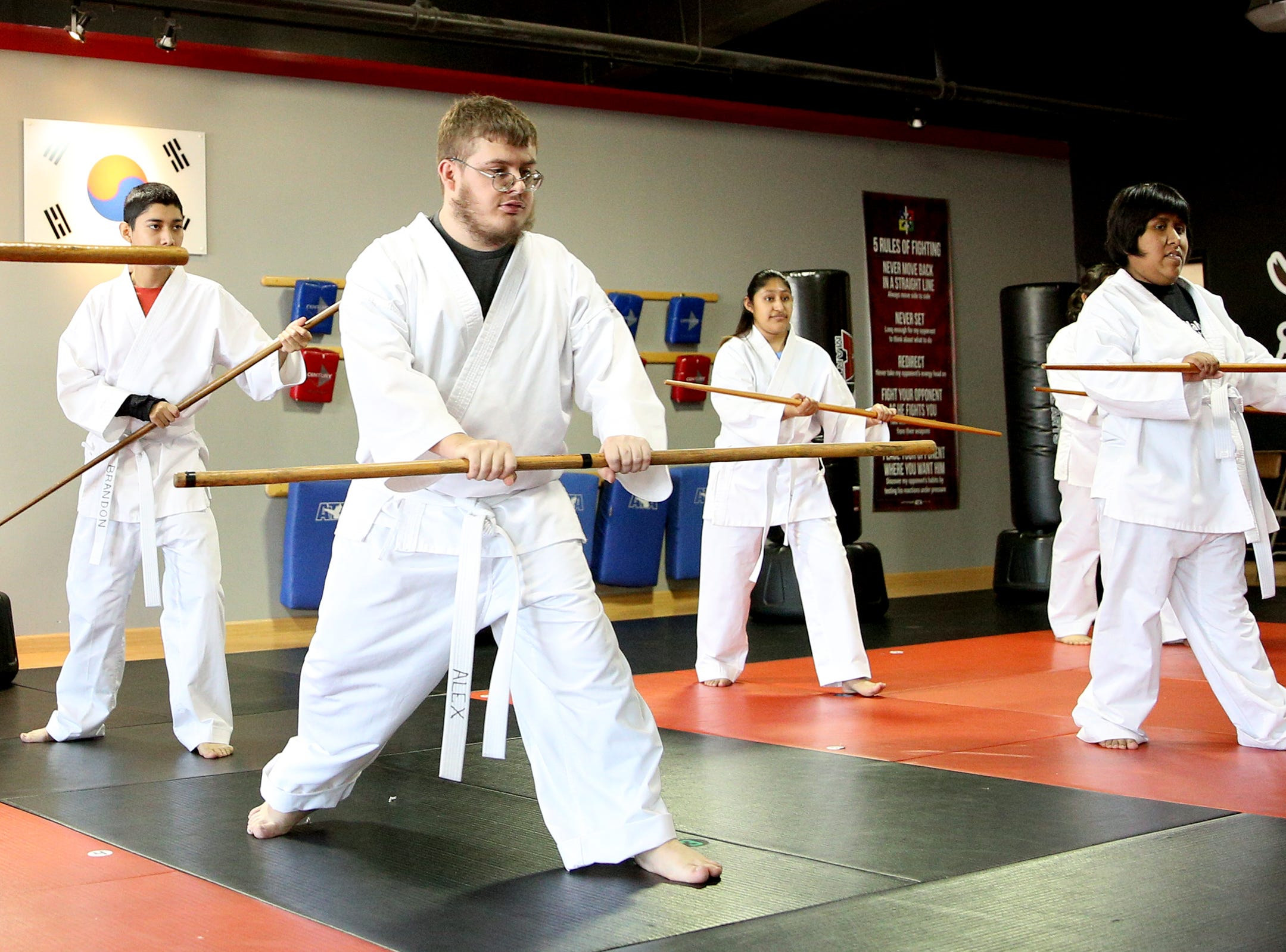 Woodburn young adults with disabilities practice using bo staffs during a class at ATA Martial Arts Keizer on Thursday, Dec. 13, 2018.