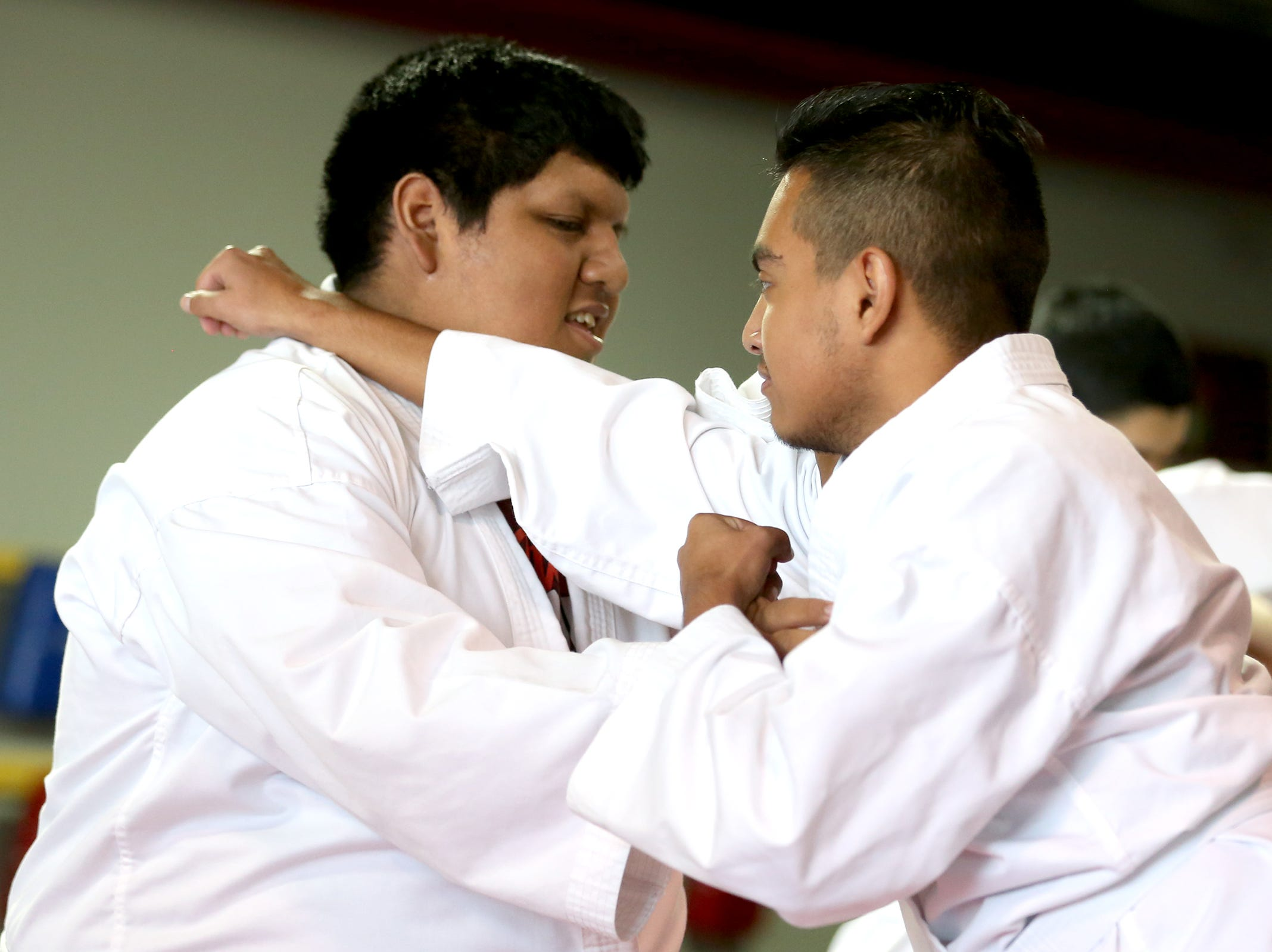 Miguel Martinez (left) and Abram Cortes (right) practice a partner exercise as part of a Woodburn School District transition program at ATA Martial Arts Keizer on Thursday, Dec.13, 2018.