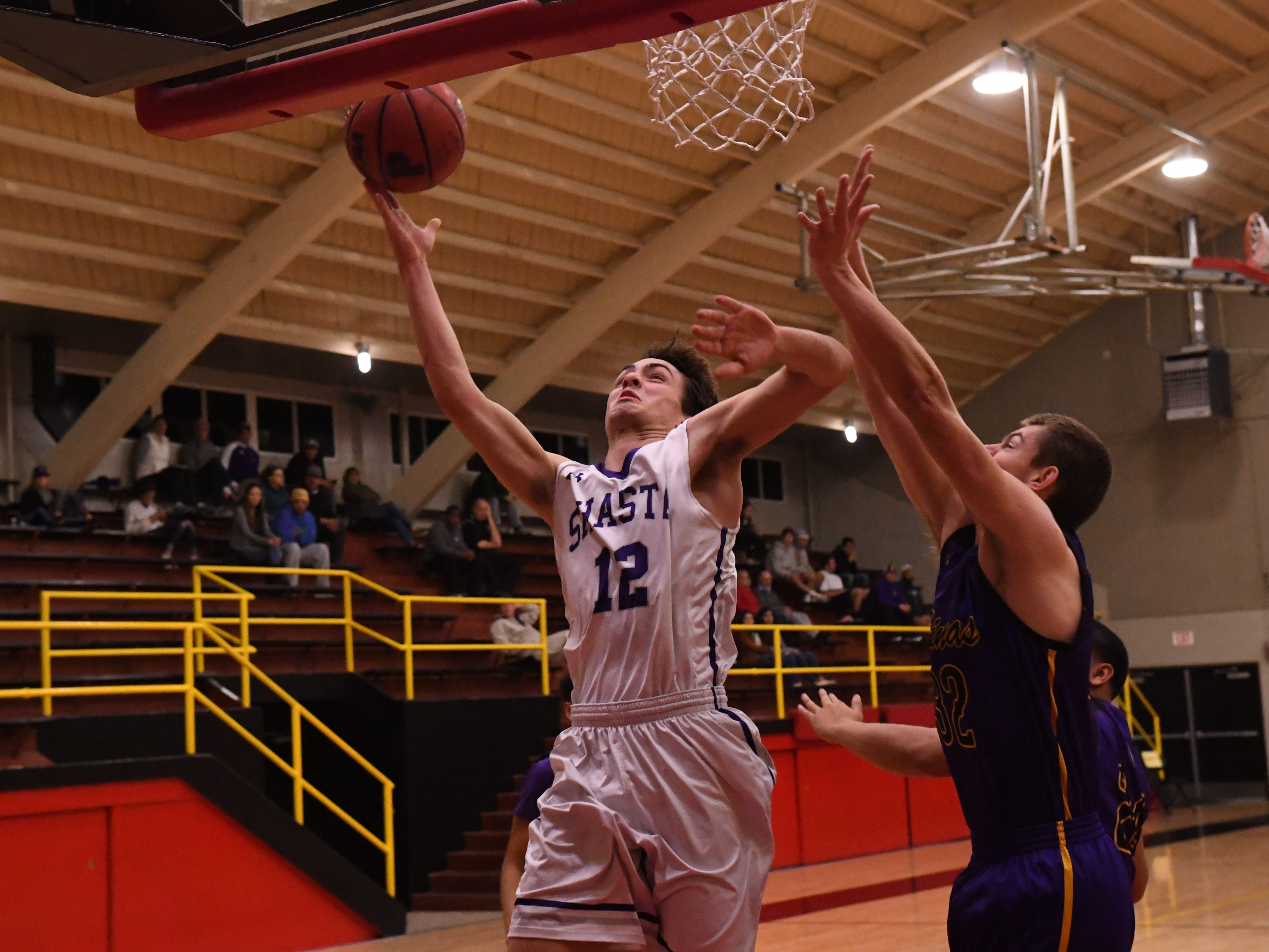 Shasta forward Cade Corontzos (12) lays up a shot in the second quarter.