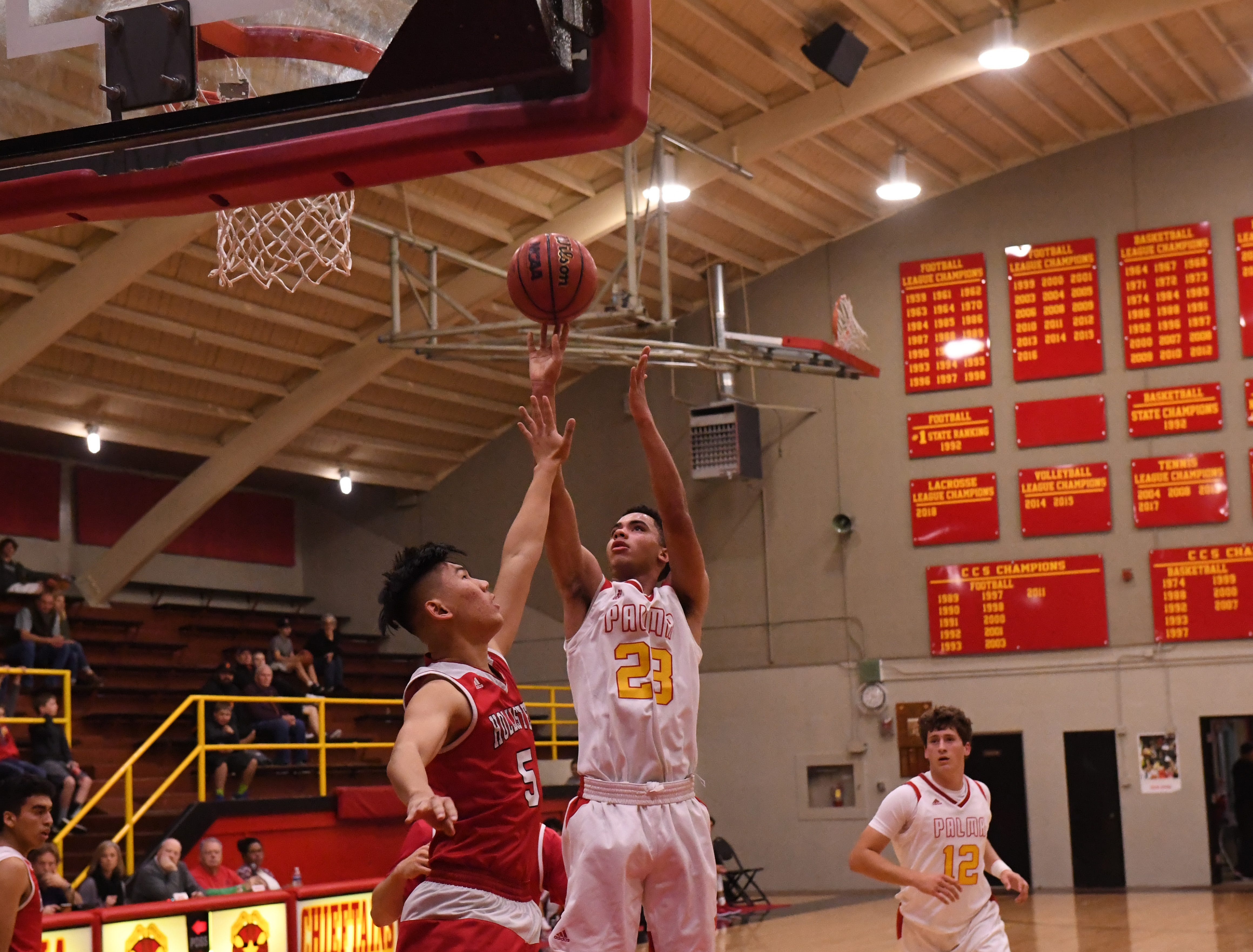 Palma forward Brenden Cannon (23) shoots from the middle of the lane.