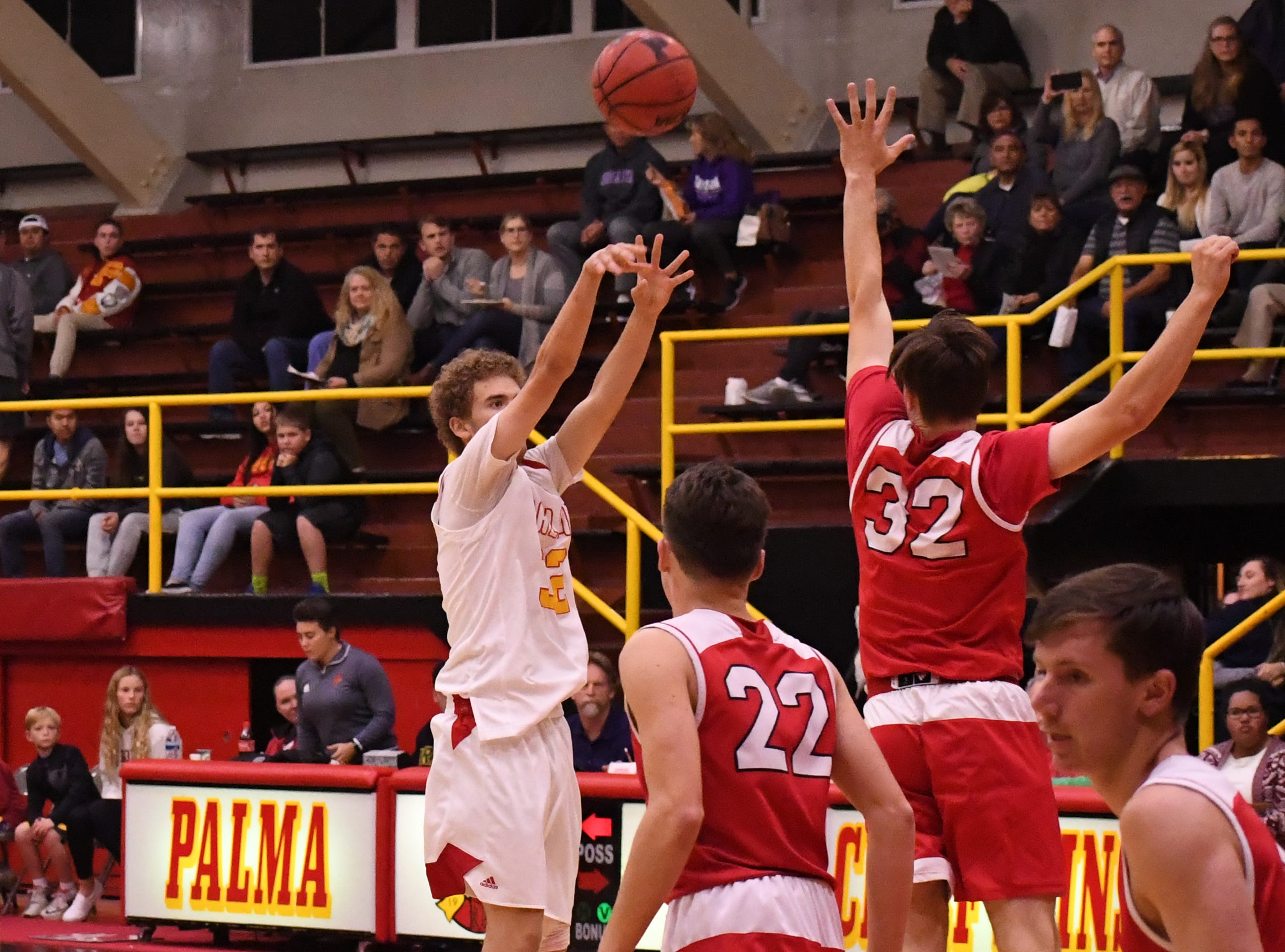 Palma forward Clin Neff (32) launches a 3-pointer in the first quarter against San Benito.