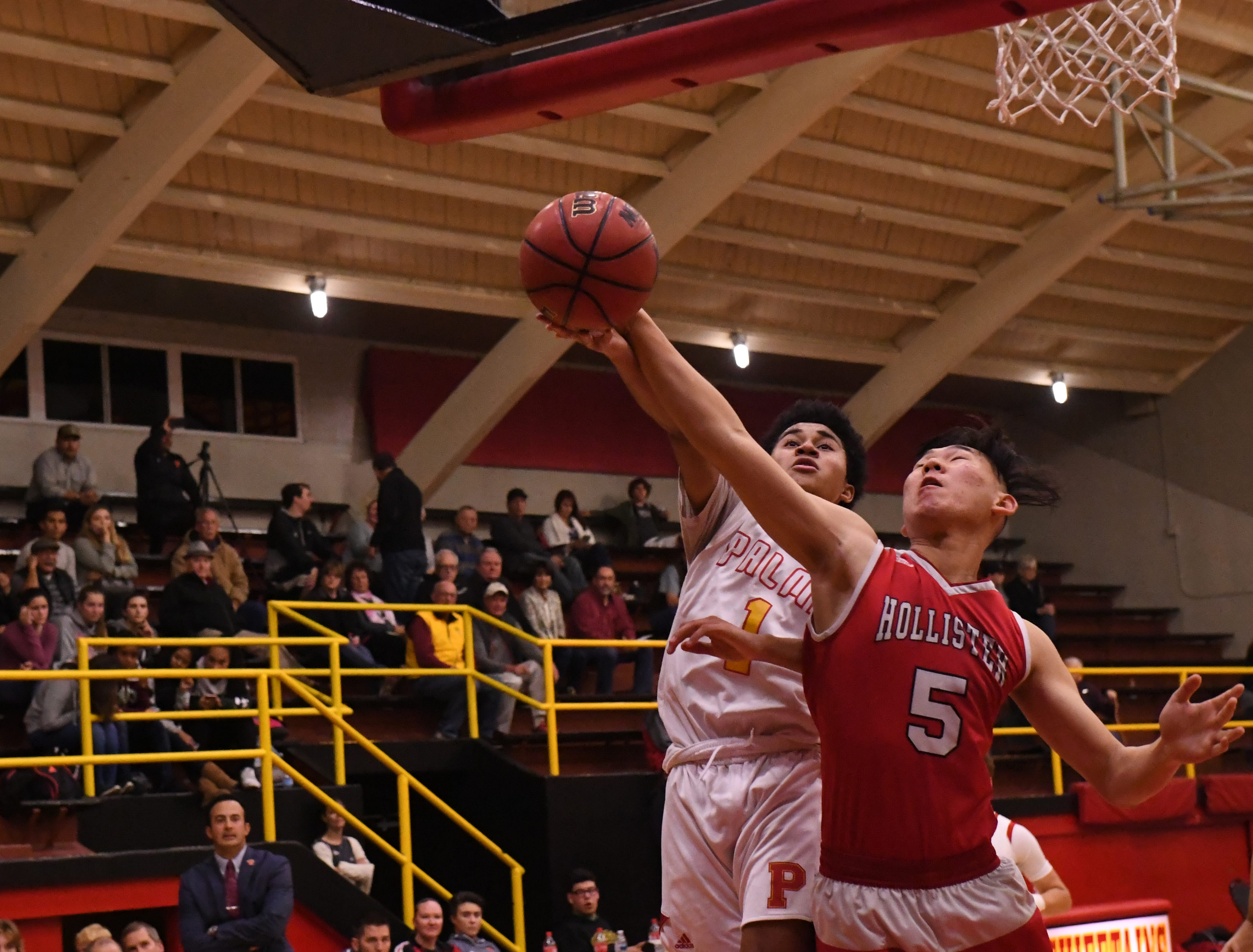 Palma guard Nate Jean-Pierre (1) tries to put a layup in while drawing a foul.