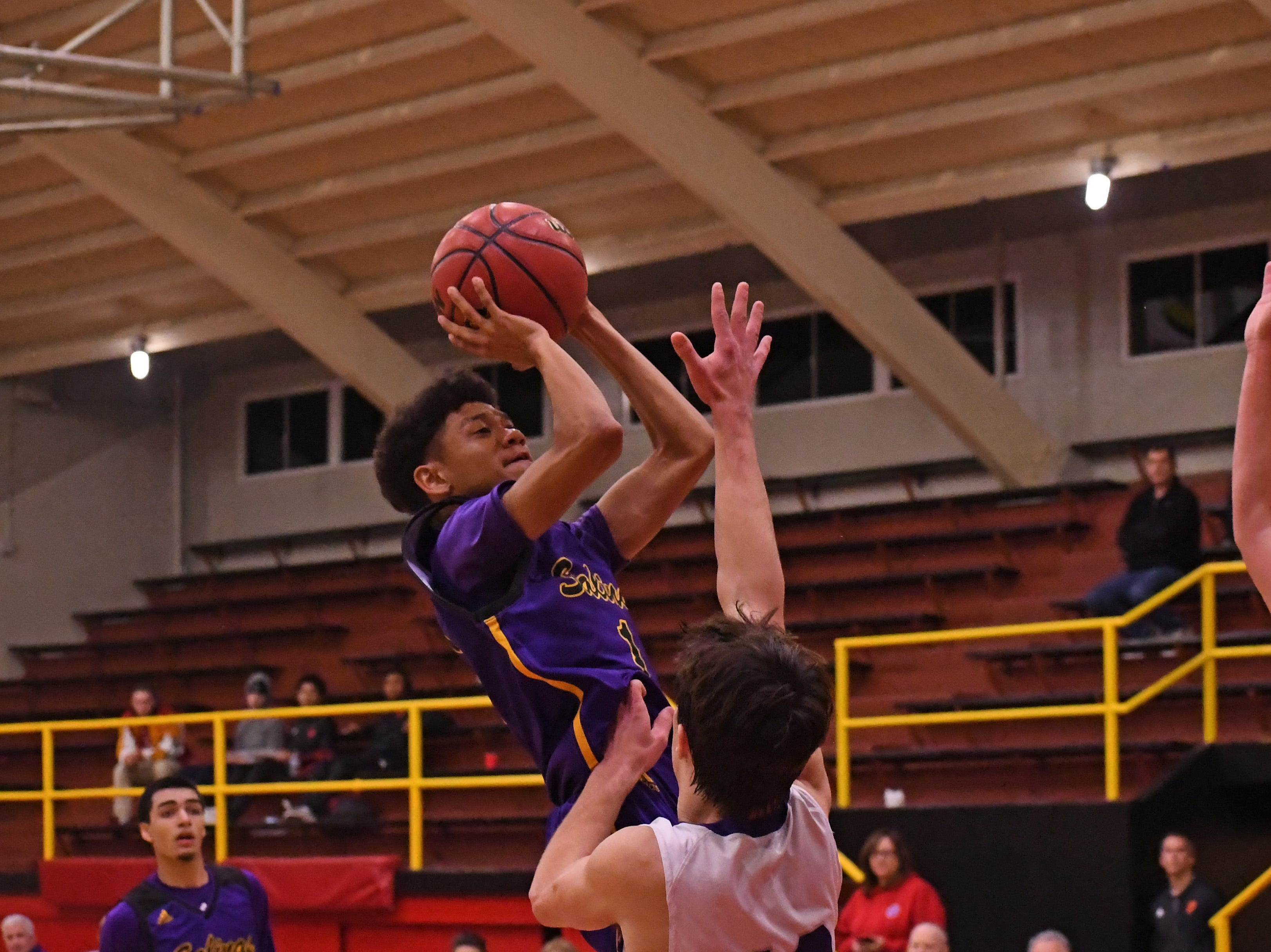 Salinas guard JoJo Paris (1) rises up for  a shot in the paint.