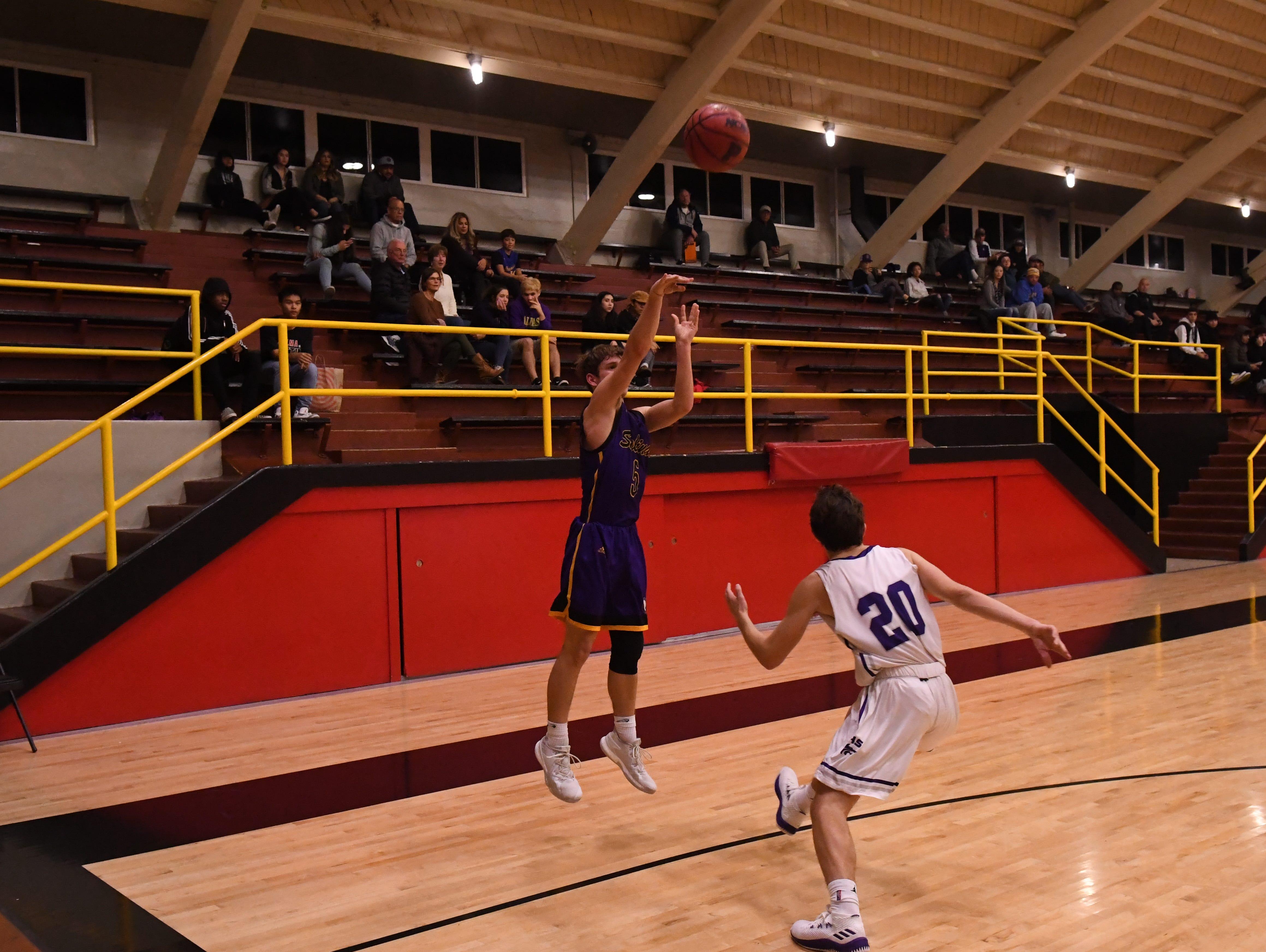 Salinas guard Ryan McKinley (2) knocks down a 3-point shot.