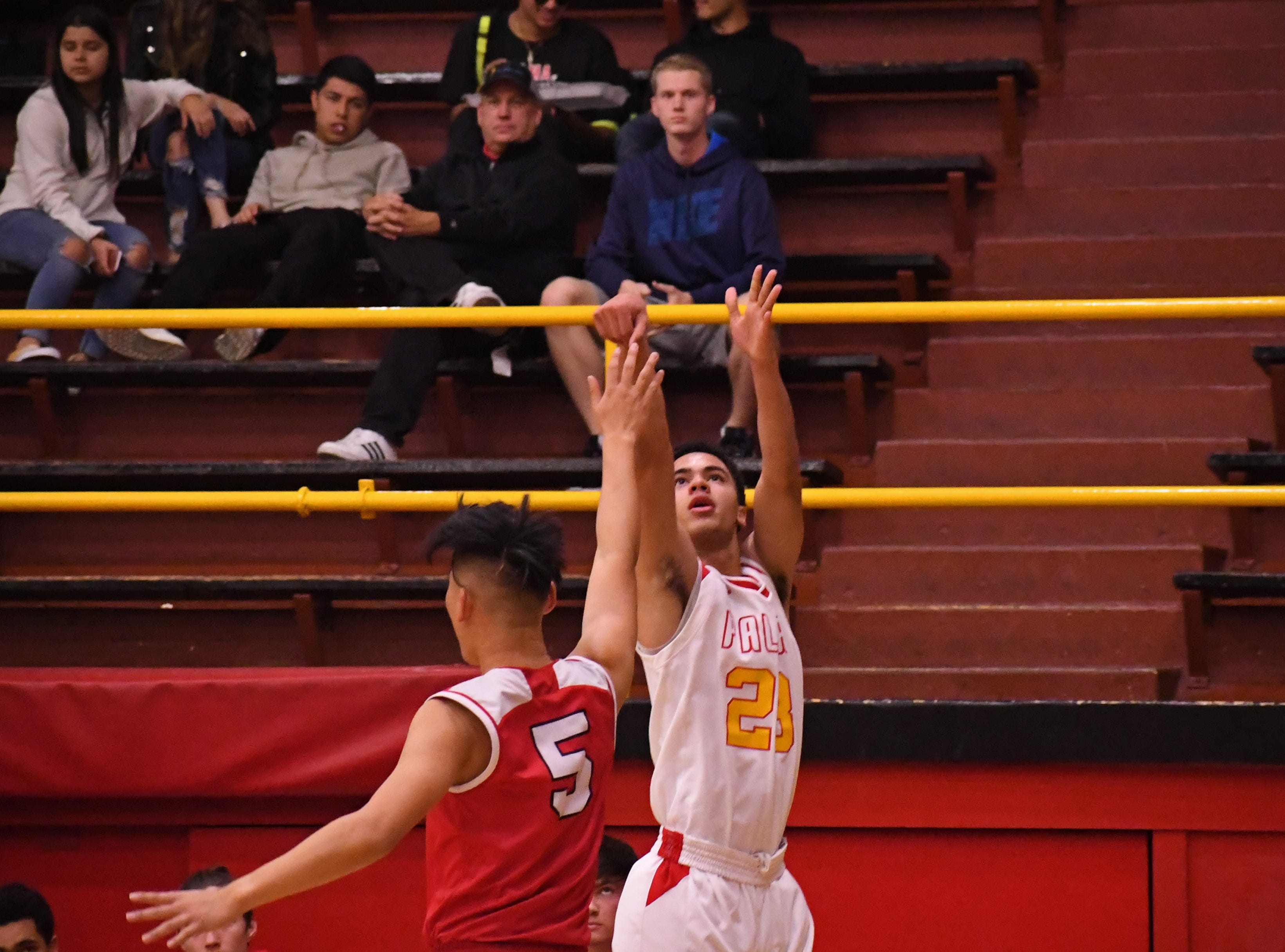 Palma forward Brenden Cannon (23) lets loose a 3-pointer from the left baseline.