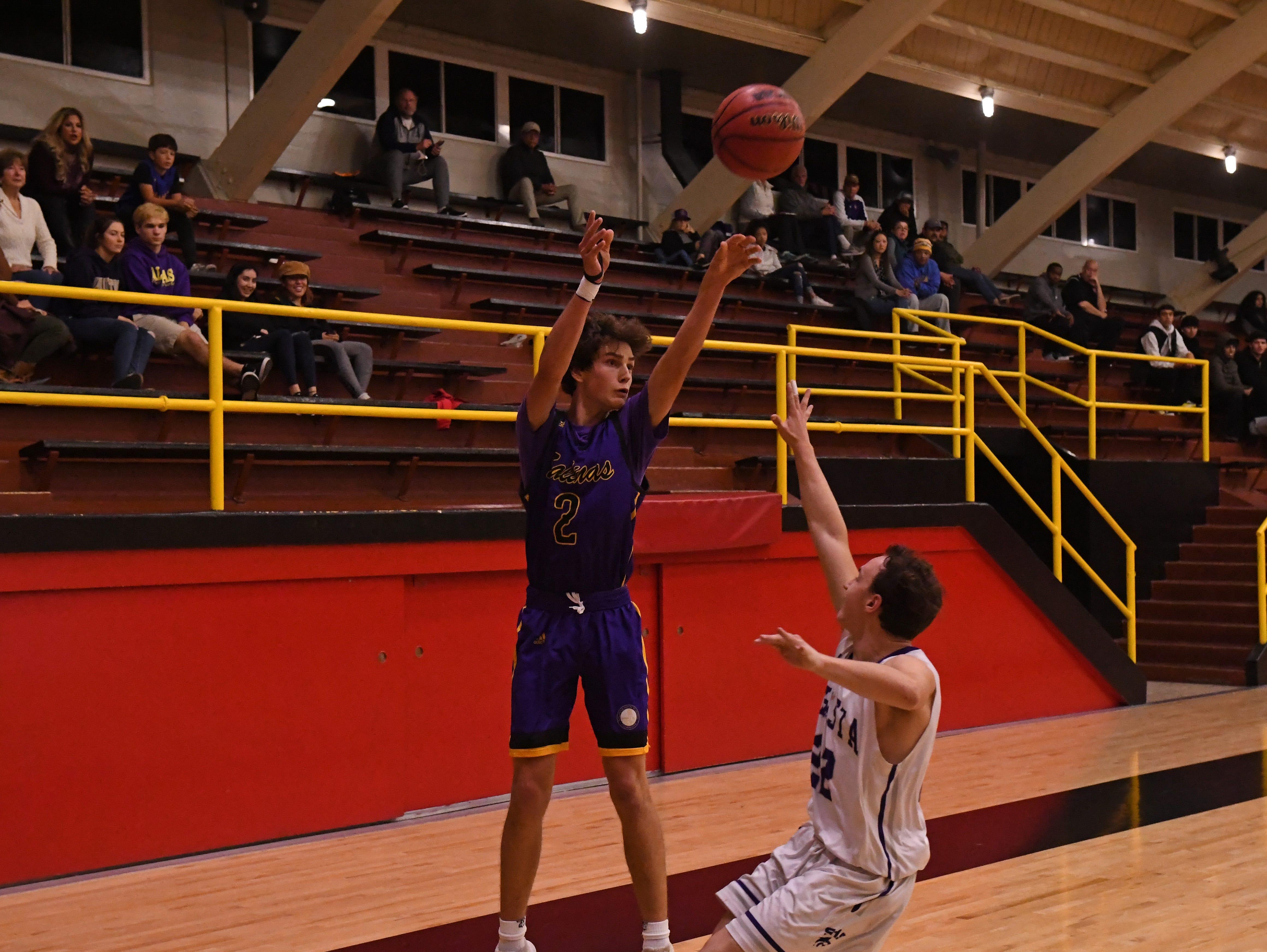 Salinas guard Parker Horton (2) fires off a 3-pointer over a closing defender.