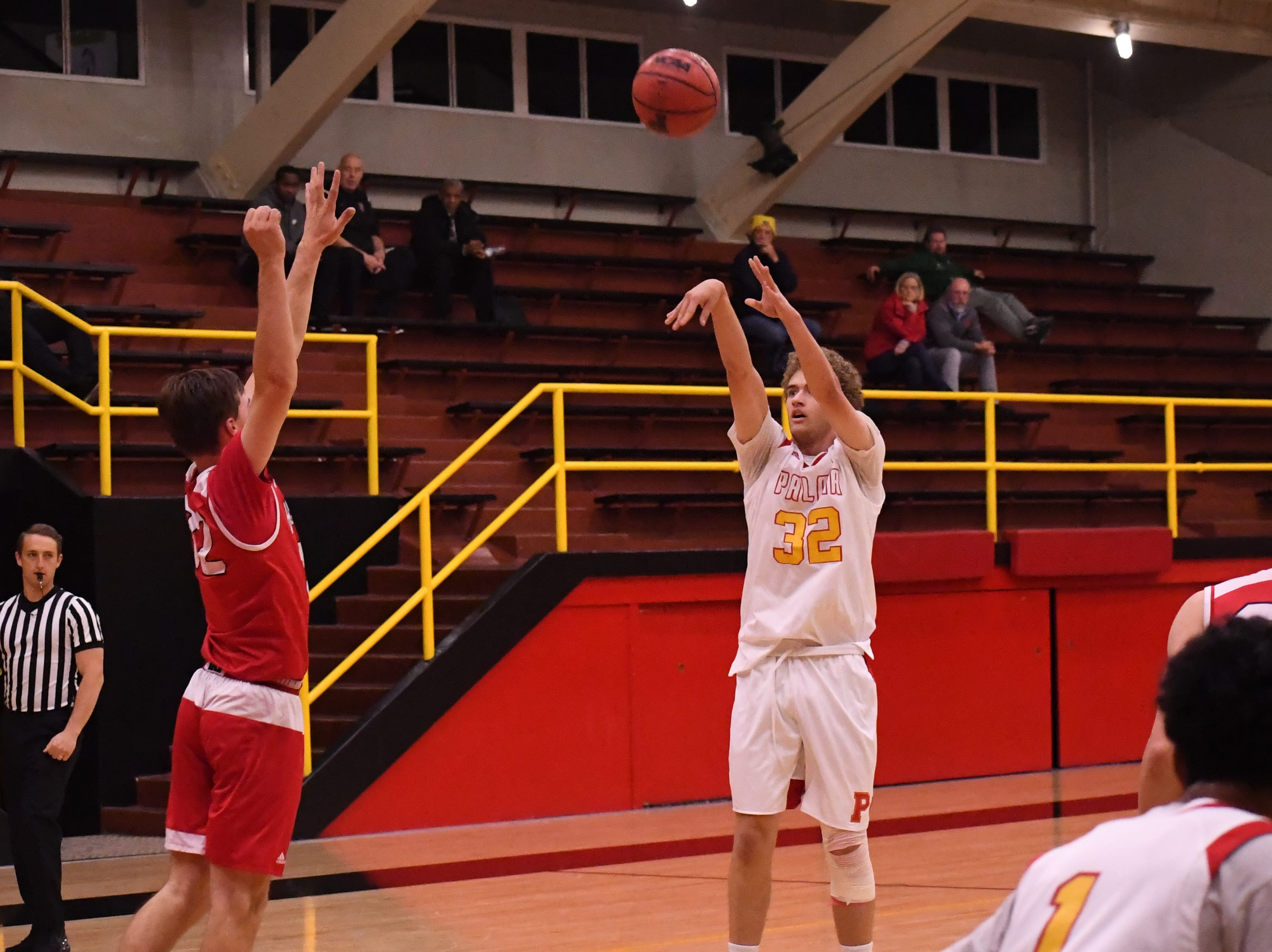 Palma forwad Colin Neff (32) knocks down a 3-point shot in the second quarter.