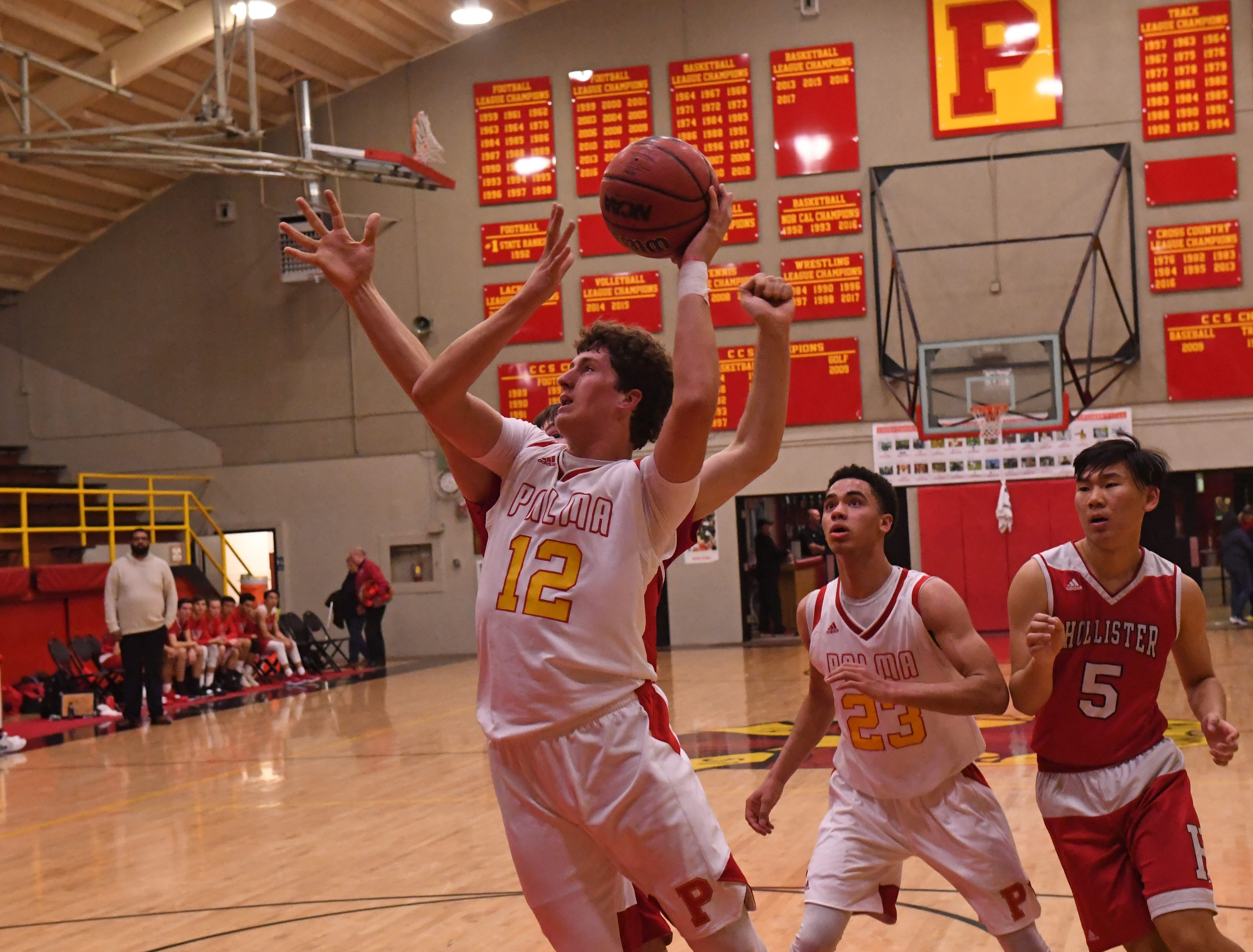 Palma forward Sam Lathos (12) goes up for a shot in the lane.