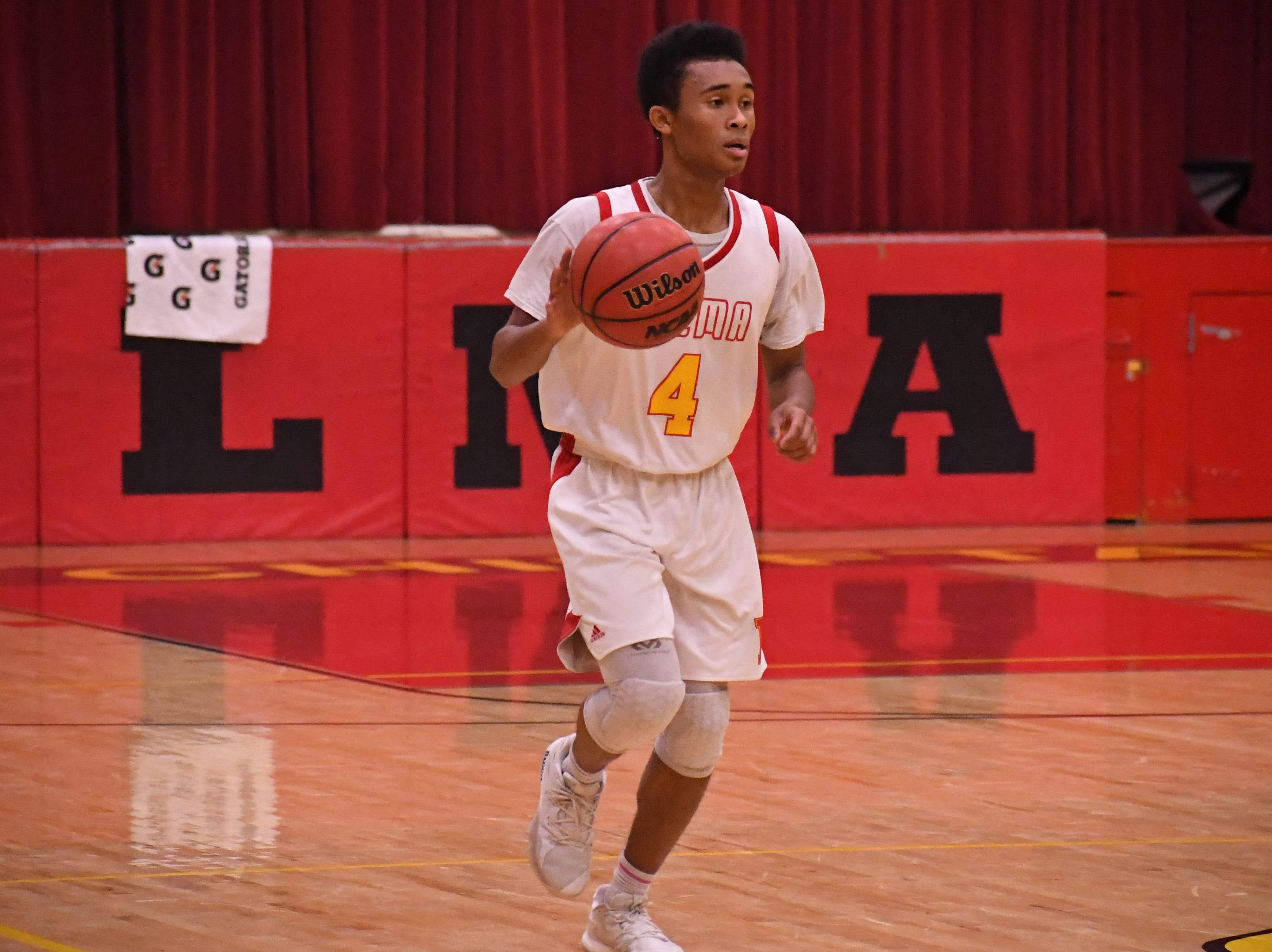 Palma guard Dante Jean-Pierre (4) takes the ball across half court to initiate the offense.
